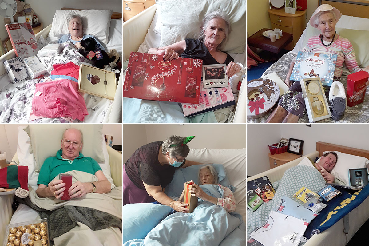 Opening Christmas gifts at Hengist Field Care Home