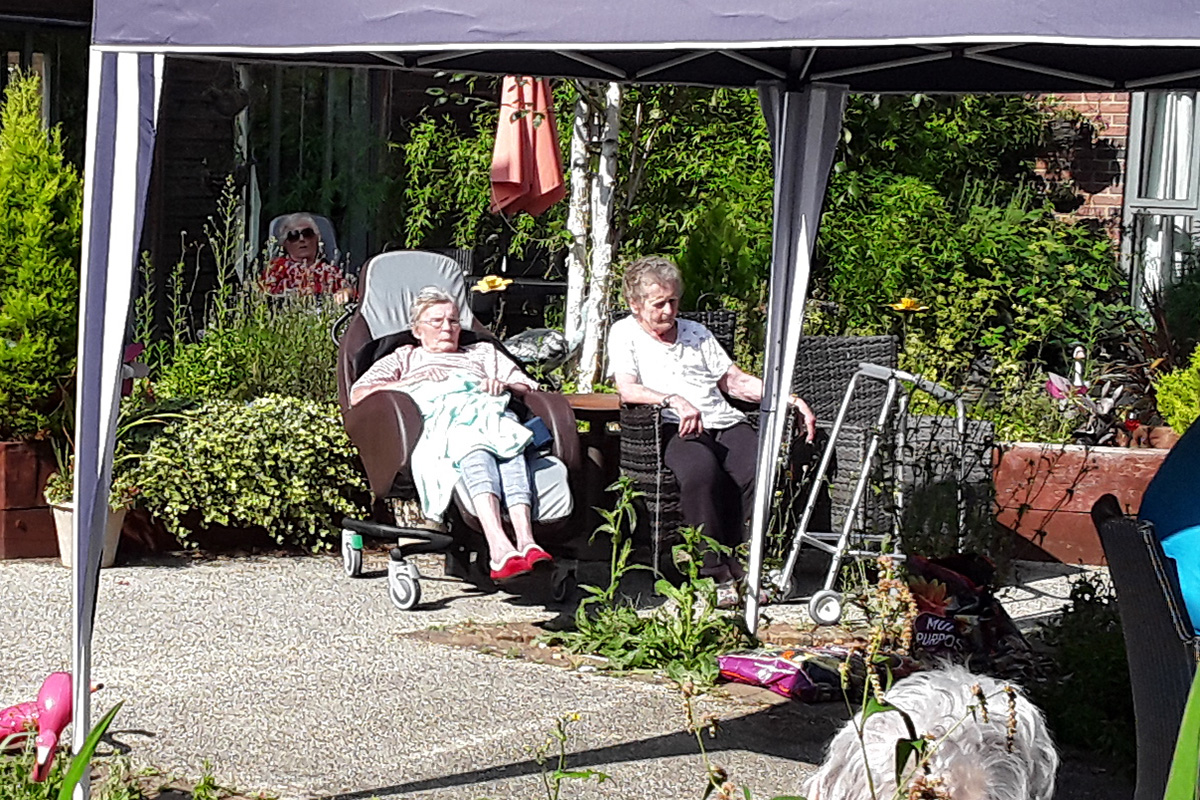 Relaxing in the sun at Hengist Field Care Home
